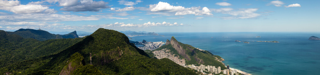 Door stickers Rio de Janeiro Rio de Janeiro vast panorama seen from mountains of the tropical rainforest with the Corcovado and Two Brothers mountain, shantytown of Rocinha and South side of the city with islands on the coastline