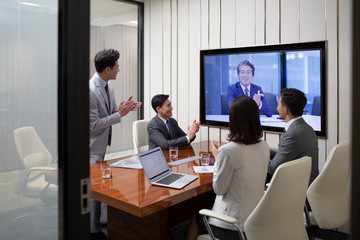Chinese business people having meeting in conference room