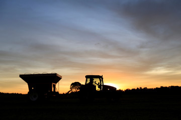 Tractor is silhouetted after harvesting soybeans at a farm in Caaguazu