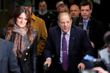 Film producer Weinstein exits the New York Criminal Courtroom with his defense attorneys Rotunno and Cheronis after the second day of jury deliberations in his sexual assault trial in the Manhattan borough of New York City, New York