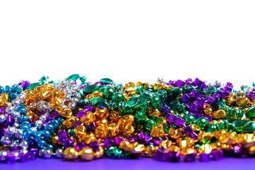 Wall Mural - Mardi Gras beads on white background