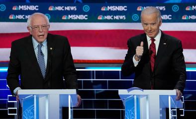 Senator Bernie Sanders speaks as former Vice President Joe Biden reacts at the ninth Democratic 2020 U.S. Presidential candidates debate at the Paris Theater in Las Vegas