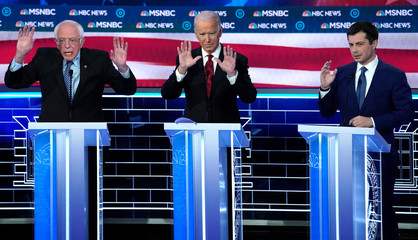 Senator Sanders, former V.P. Biden and former South Bend Mayor Buttigieg discuss an issues during the ninth Democratic 2020 U.S. presidential debate at the Paris Theater in Las Vegas, Nevada, U.S.