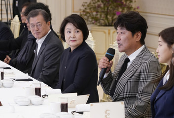 Actor Song Kang-ho of the four Oscar award-winning film 'Parasite' speaks next to South Korean President Moon Jae-in and first lady Kim Jung-sook during a luncheon at the Presidential Blue House in Seoul