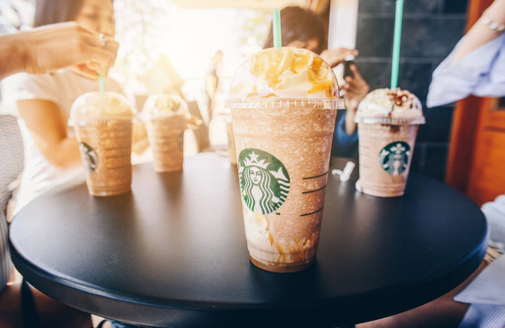 Napier, New Zealand -April/01/2018- : Tourist enjoying their holiday with a cups of Starbucks Frappuccino at Napier Starbucks coffee shop.