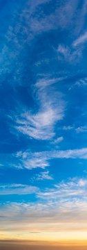 Fantastic clouds at sunrise, vertical panorama