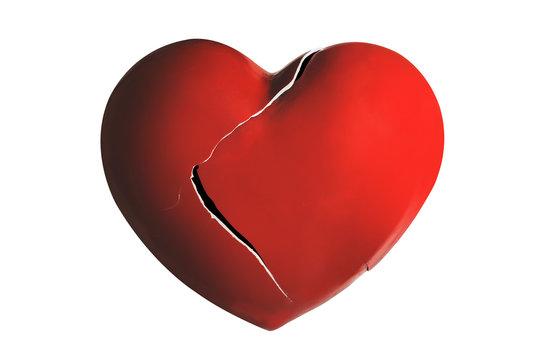Broken ceramic red heart isolated on white background