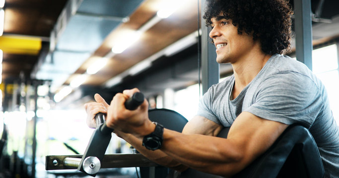 Portrait of healthy fit man working out in gym