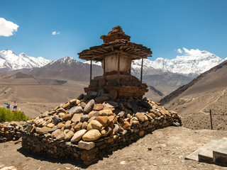 Wall Murals Nepal An ancient Buddhist chorten on top of a hill in the village of Kagbeni in Upper Mustang. Tibetan text on the mani stones are Buddhist chants signifying peace and well-being for the world.