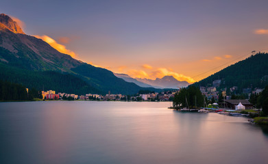 Sunset above St. Moritz with lake and Swiss Alps in Switzerland