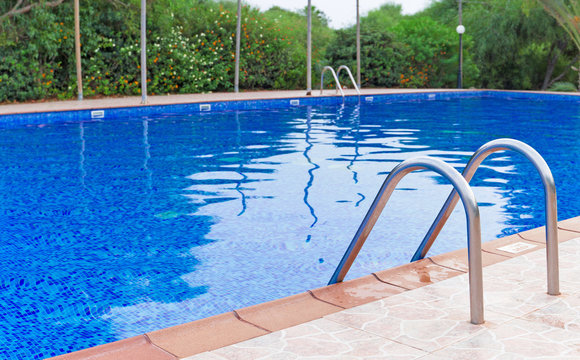 Outdoor swimming pool at summer time.