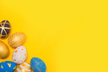 Easter golden decorated eggs on background. Minimal easter