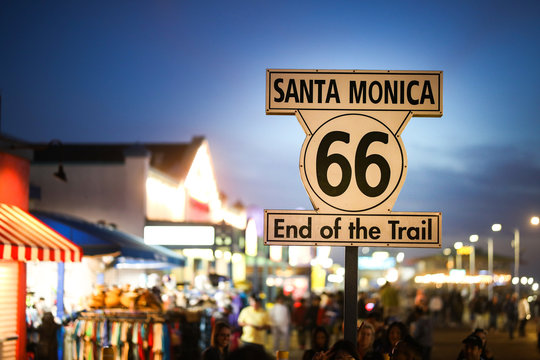 Route 66 sign on Santa Monica pier at the beach in California