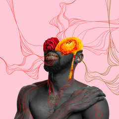 African-american man with head filled by flowers on coral background. Copyspace for your proposal....