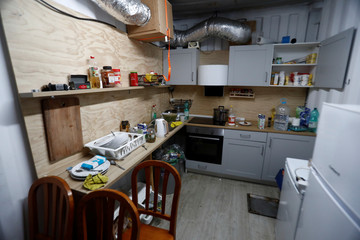 A kitchen is pictured in an illegal underground tobacco factory during a police raid in Monda