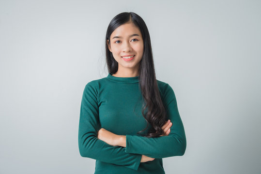 Beautiful young asian woman smiling and looking happily.