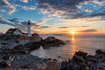 Sunrise at Portland Head Lighthouse in Cape Elizabeth, New England, Maine, USA.