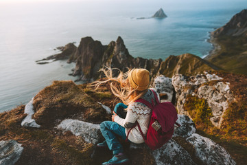 Woman relaxing alone travel in Norway adventure vacations healthy lifestyle backpacking Vesteralen landscape rocks and sea aerial view