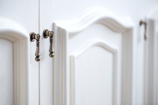 Detail of vintage white cabinet - selective focus, copy space