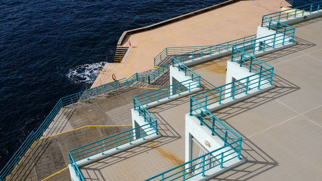 Blue railings and terraces at the seaside