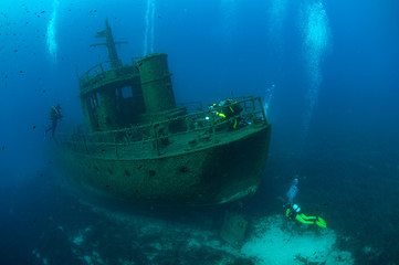 ship wreck underwater.scuba diver taking photos ship wreck underwater