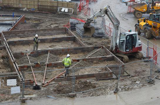 Builders work at a Barratt housing development near Haywards Heath