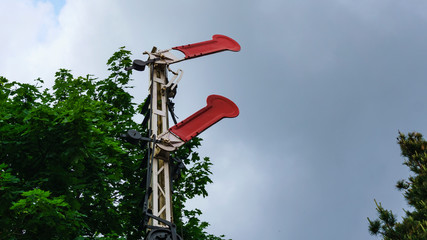 Old preserved semaphore signal on dramatic sky background. Fototapete