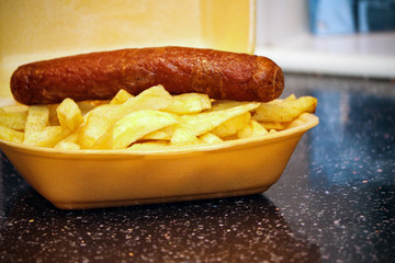Sausage and chips from a takeaway