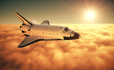 Fotomurales - Space Shuttle Above The Clouds During Sunrise