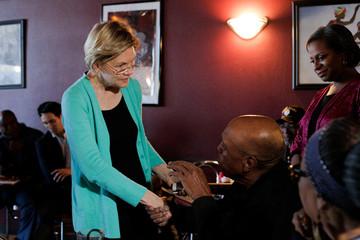 U.S. Democratic presidential candidate Senator Elizabeth Warren greets Bill Mangum at EllaEm's Soul Food in North Las Vegas