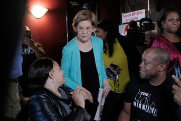 U.S. Democratic presidential candidate Senator Elizabeth Warren greets customers at EllaEm's Soul Food in North Las Vegas