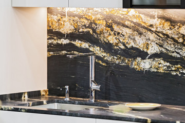 Beautiful modern kitchen design, kitchen faucet, black and gold stone marble countertop kitchen