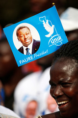 A supporter of president Gnassingbe and presidential candidate of UNIR attend a rally in Lome