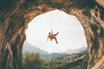 Rock climber hanging on a rope.
