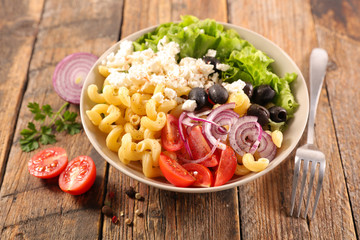 Fotorollo Buddha buddha bowl with pasta, feta cheese, tomato, onion, and lettuce