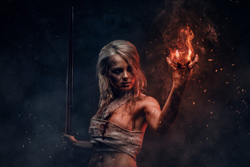 Fantasy woman warrior wearing rag cloth stained with blood and mud in the heat of battle. Cosplayer as Ciri from The Witcher
