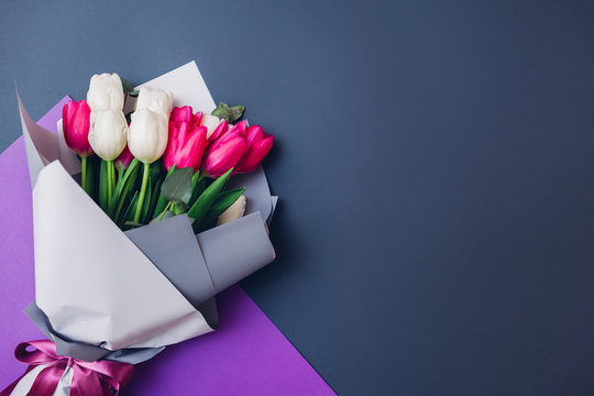 Spring flowers. Women's day background. Bouquet of white and pink tulips. Present gift for Mother's day. Space