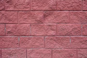 Red rugged cinder block texture background.