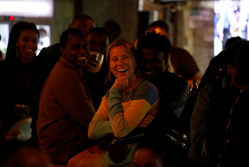 People in the audience laugh during a standup show by Kenyan comedian Brian Onjoro at the Kez's Kitchen restaurant in Nairobi