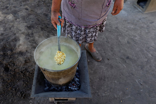 Guadalupe Molina prepares dough for tortilla in Tepeteopan