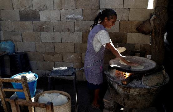 Margarita Bustamante prepares tortillas at her house in Magdalena Cuayucatepec