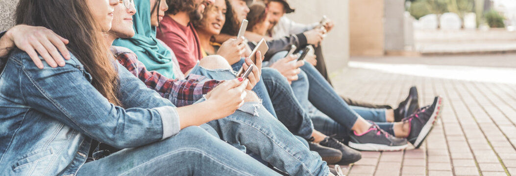 Group of friends using smart mobile phones app - Teenagers addiction to new technology trends - Concept of youth, tech, social and friendship - Focus on second person hand