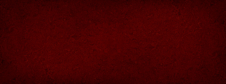 Red abstract background. Toned fiberboard texture. Close-up. Burgundy vintage background. Black red grunge banner with copy space for your design.