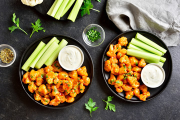 Cauliflower buffalo wings with celery and sauce