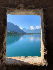 Door stickers Chocolate brown MONTREUX, SWITZERLAND - AUGUST 8, 2019: Beautiful panoramic view. at Geneva lake through the window of the castle Chillon.