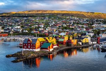 Sunrise scene of capital city Torshavn in Faroe Islands in North Atlantic. Urban scene of scandinavian city in warm golden sunlight.