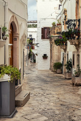 Walking charming white streets of Locorotondo in Puglia, Italy
