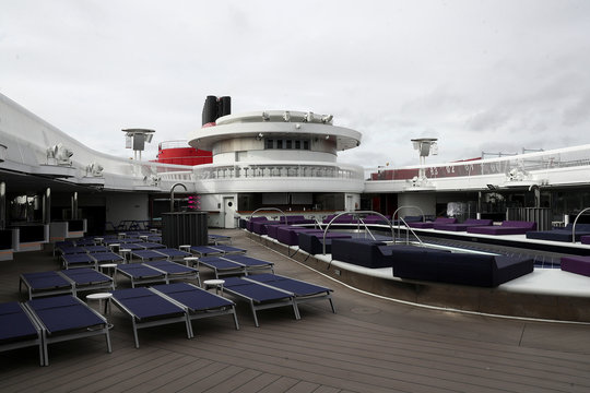 Sun loungers sit on the deck of a Virgin Voyages Scarlet Lady cruise liner at Dover Port in Dover