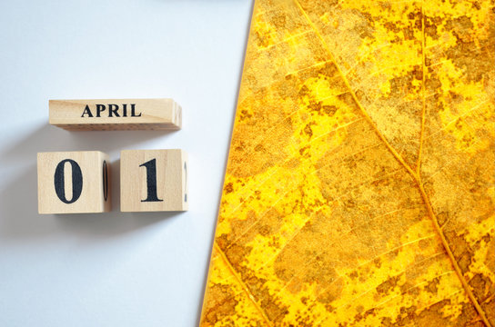April 1, Empty white - Yellow leaf pattern background.