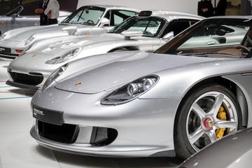 Row of various Porsche sports cars showcased at the Paris Motor Show. PARIS - OCT 3, 2018.
